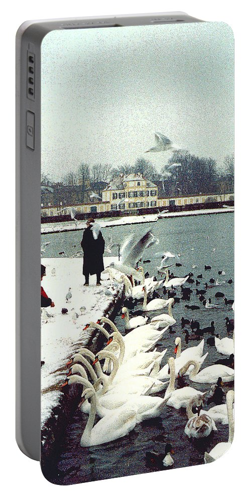 Swans Portable Battery Charger featuring the photograph Boy Feeding Swans- Germany by Nancy Mueller