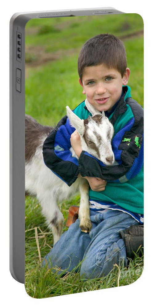 Boy Portable Battery Charger featuring the photograph Boy With Goat by Inga Spence