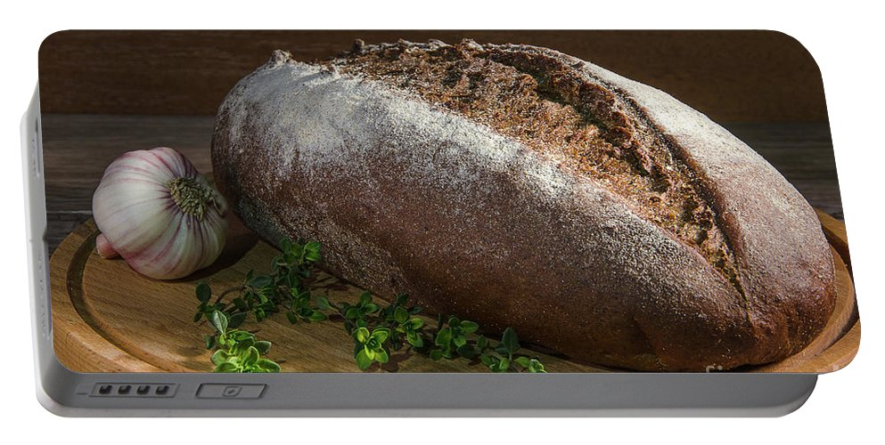 Organic Portable Battery Charger featuring the photograph Bread With Spice by Nataly Raikhel