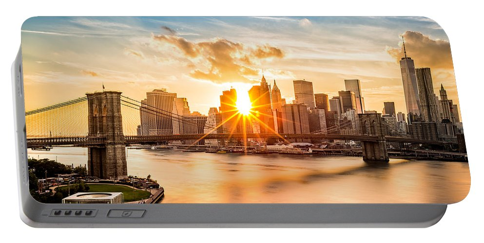America Portable Battery Charger featuring the photograph Brooklyn Bridge and the Lower Manhattan skyline at sunset by Mihai Andritoiu