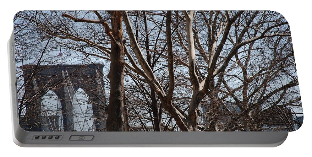 Architecture Portable Battery Charger featuring the photograph Brooklyn Bridge Thru The Trees by Rob Hans