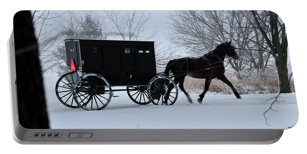 Amish Portable Battery Charger featuring the photograph Buggy On Winter Road by David Arment