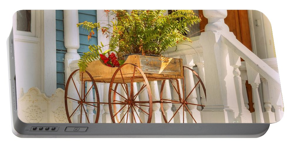 Planter Portable Battery Charger featuring the photograph Buggy Planter by Linda Covino
