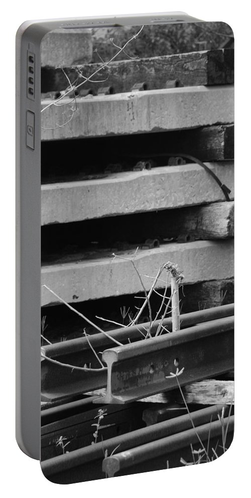 Black And White Portable Battery Charger featuring the photograph Building Tracks by Rob Hans