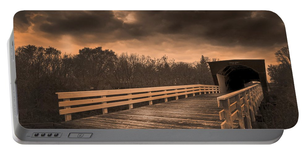 Roseman Bridge Portable Battery Charger featuring the photograph Built In 1883 Movie Clint Eastwood by Randall Branham