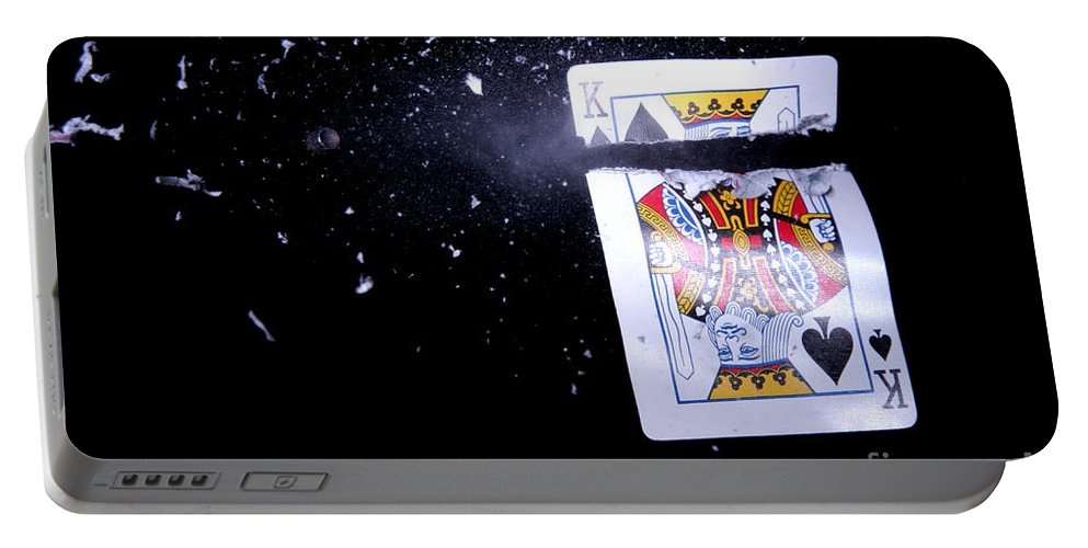 Card Portable Battery Charger featuring the photograph Bullet Hitting A Playing Card by Ted Kinsman