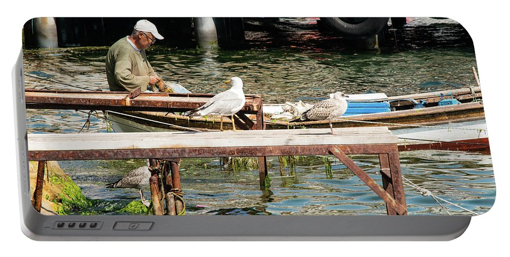 Burgazada Island Portable Battery Charger featuring the photograph Burgazada Island Fisherman by Bob Phillips