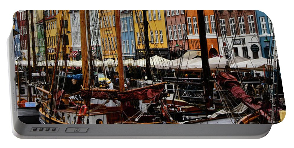 Old Boats Sailboats Nyhavn Copenhagen Denmark Canal Waterfront Colorful Houses Portable Battery Charger featuring the photograph Busy Nyhavn by Marko Ristic