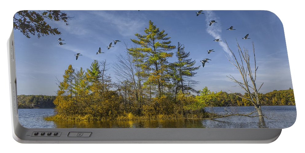 Beautiful Portable Battery Charger featuring the photograph Canada Geese Flying By A Small Island On Hall Lake by Randall Nyhof