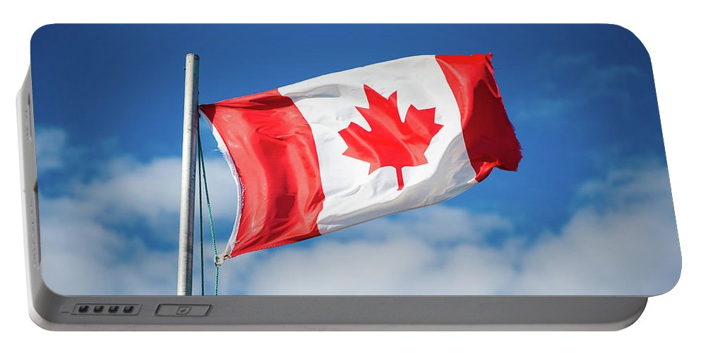Canada Portable Battery Charger featuring the photograph Canadian Flag Flying Proudly by Selinda Van Horn