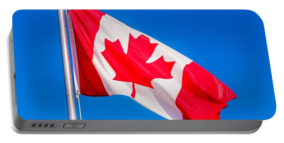 Flag Portable Battery Charger featuring the photograph Canadian Flag by Lonnie Paulson