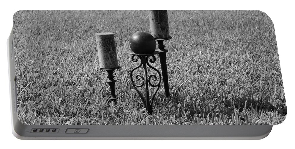 Black And White Portable Battery Charger featuring the photograph Candles In Grass by Rob Hans
