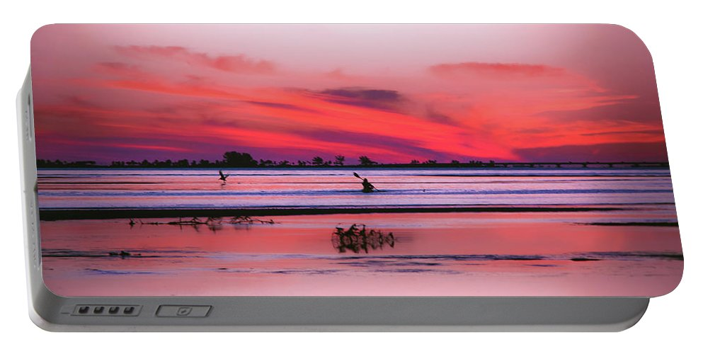 Canoe Portable Battery Charger featuring the photograph Canoeing On Color by Michael Frizzell