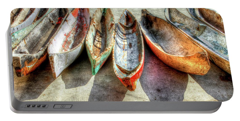 The Portable Battery Charger featuring the photograph Canoes by Debra and Dave Vanderlaan