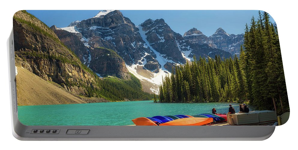 Alberta Portable Battery Charger featuring the photograph Canoes On A Jetty At Moraine Lake In Banff National Park, Canada by Miroslav Liska