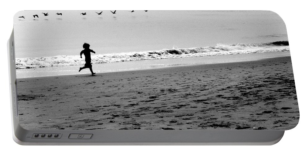 Photograph Portable Battery Charger featuring the photograph Carefree by Jean Macaluso