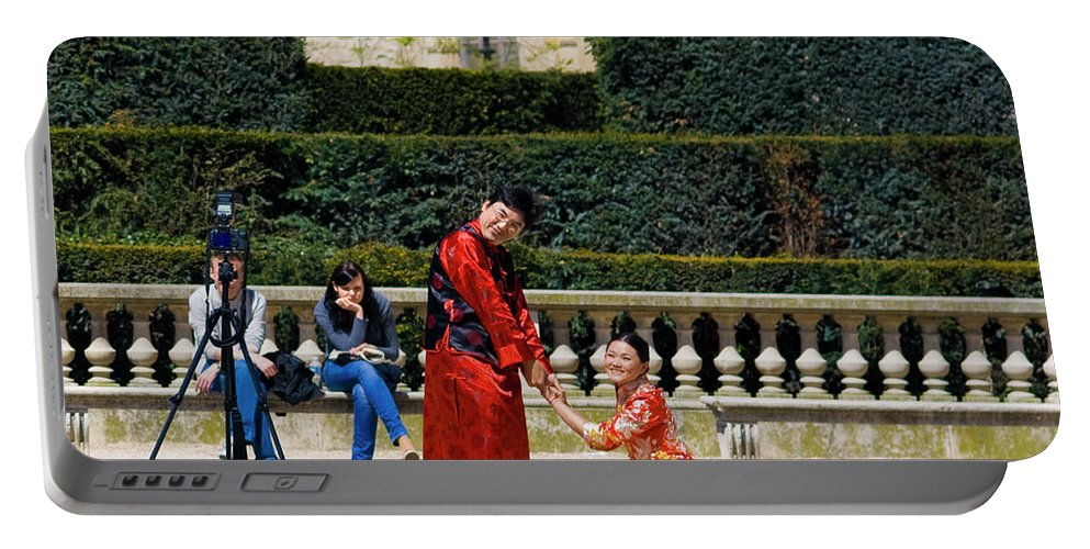 Paris Portable Battery Charger featuring the photograph Carrousel Wedding by Sam Gish