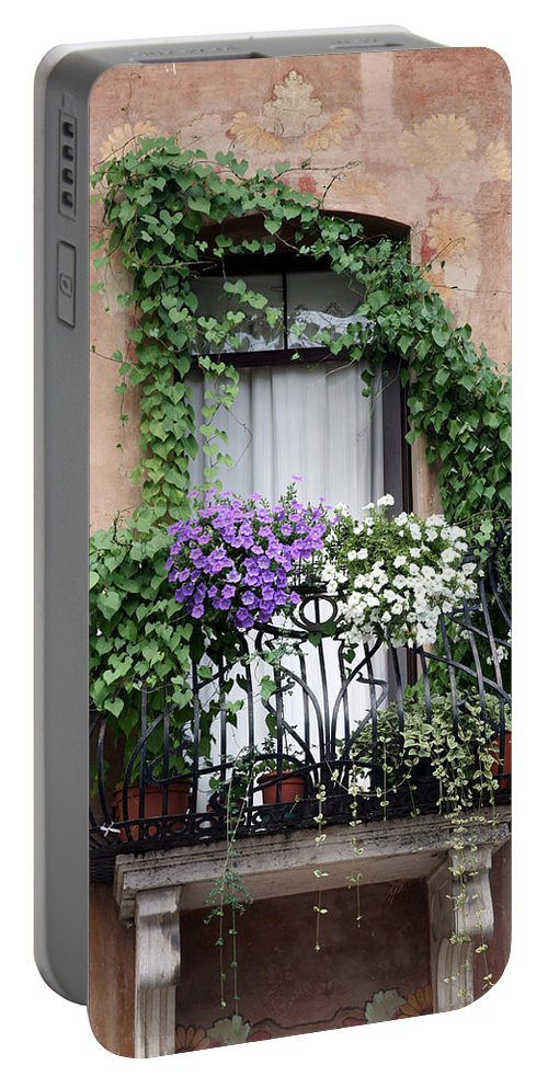 Windows And Doors Portable Battery Charger featuring the photograph Cascading Floral Balcony by Donna Corless