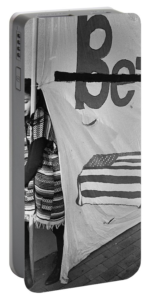 Casket On Banner Young Girl Anti Gulf War Rally Tucson Arizona 1991 Portable Battery Charger featuring the photograph Casket On Banner Young Girl Anti Gulf War Rally Tucson Arizona 1991 by David Lee Guss