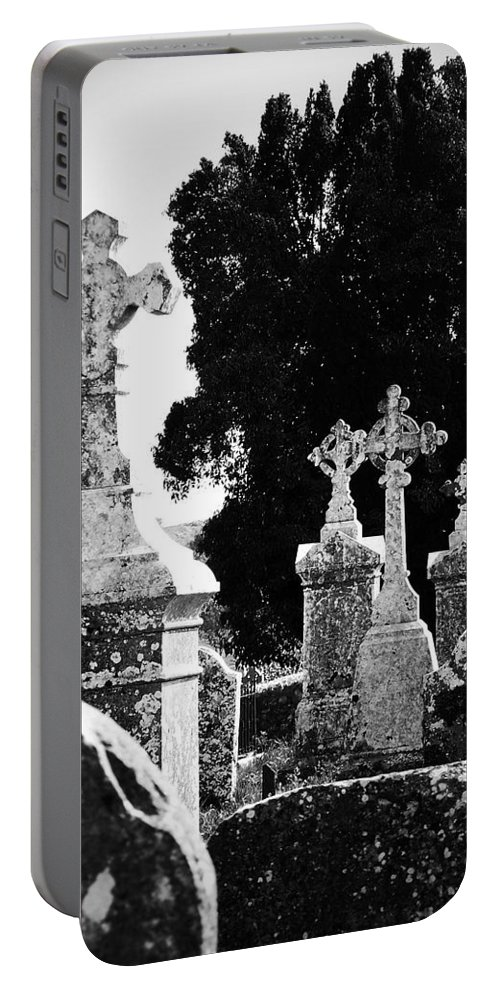 Celtic Portable Battery Charger featuring the photograph Celtic Crosses At Fuerty Cemetery Roscommon Ireland by Teresa Mucha