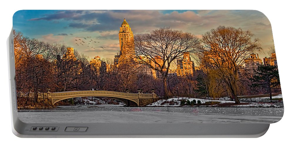 Landscape Portable Battery Charger featuring the photograph Central Parks Famous Bow Bridge by Chris Lord