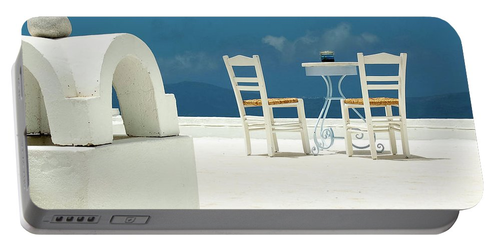 Santorini Portable Battery Charger featuring the photograph Chairs Of Santorini by Erin Marie