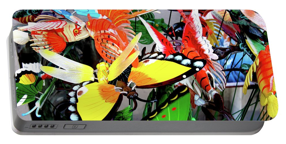 Butterfly Portable Battery Charger featuring the photograph Chinatown Toys by Noel Baebler