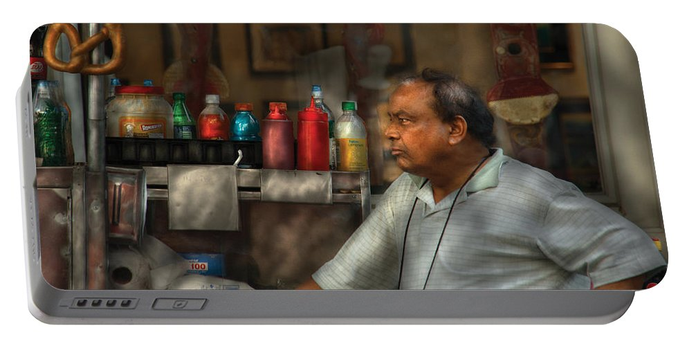 Savad Portable Battery Charger featuring the photograph City - Ny - The Pretzel Vendor by Mike Savad