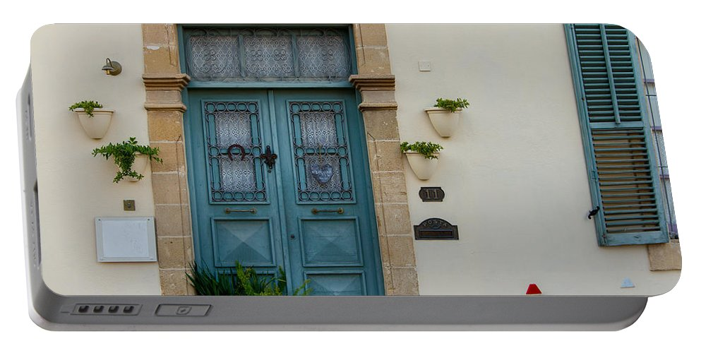 Chrysaliniotissa Portable Battery Charger featuring the photograph Classic House Entrance In Old Nicosia by Iordanis Pallikaras