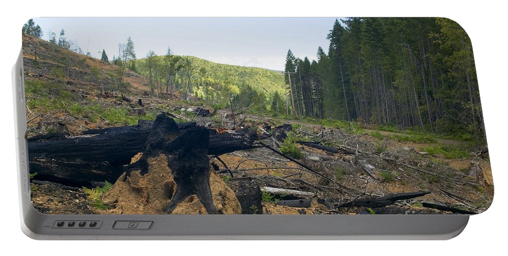 Logging Portable Battery Charger featuring the photograph Clearcut Logging Site by Inga Spence