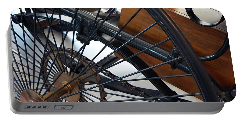 Close Portable Battery Charger featuring the photograph Close Up On Vintage Wheel Of Bicycle by Oana Unciuleanu