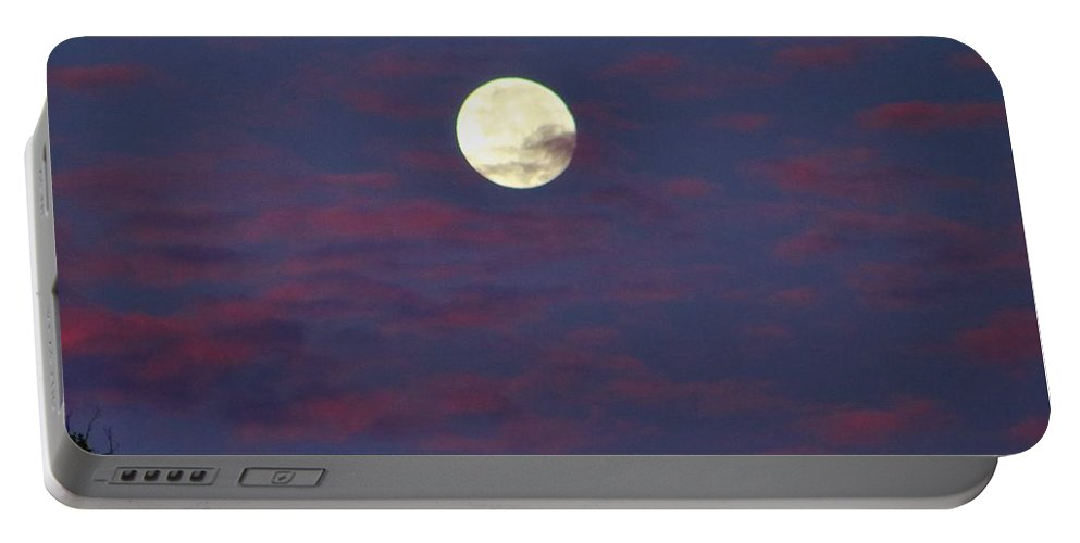 Moon Portable Battery Charger featuring the photograph Closeup Moonset In Colorful Clouds by Kathryn Meyer
