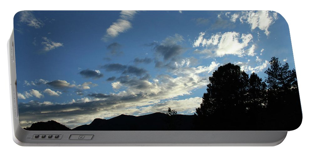 Sky Portable Battery Charger featuring the photograph Cloud Sweep And Silhouette by Ric Bascobert