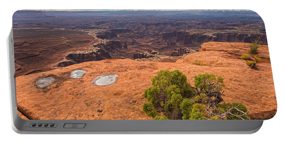Canyonlands National Park Portable Battery Charger featuring the photograph Clouds Junipers And Potholes by Angelo Marcialis