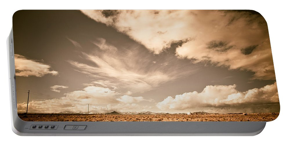 Storm Portable Battery Charger featuring the photograph Cloudy Plain by Scott Sawyer