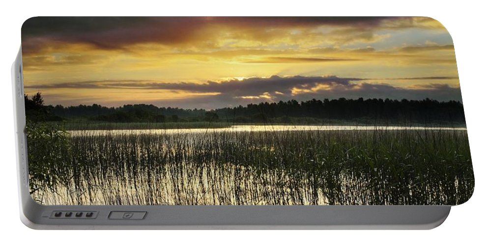 Cloud Portable Battery Charger featuring the photograph Cloudy Sunrise by Vadzim Kandratsenkau