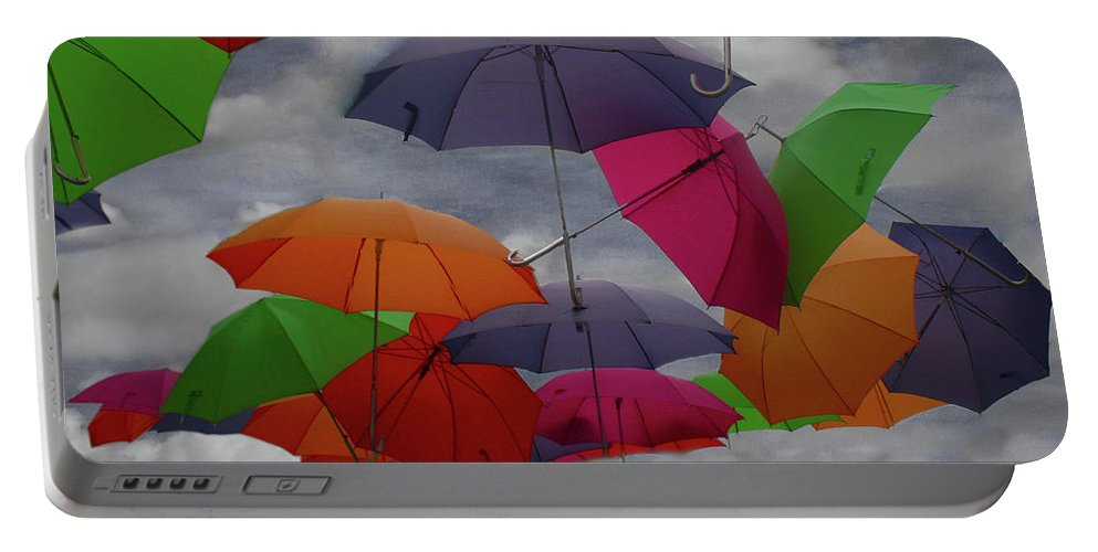 Cloud Portable Battery Charger featuring the photograph Cloudy With A Chance Of Umbrellas by Wayne King