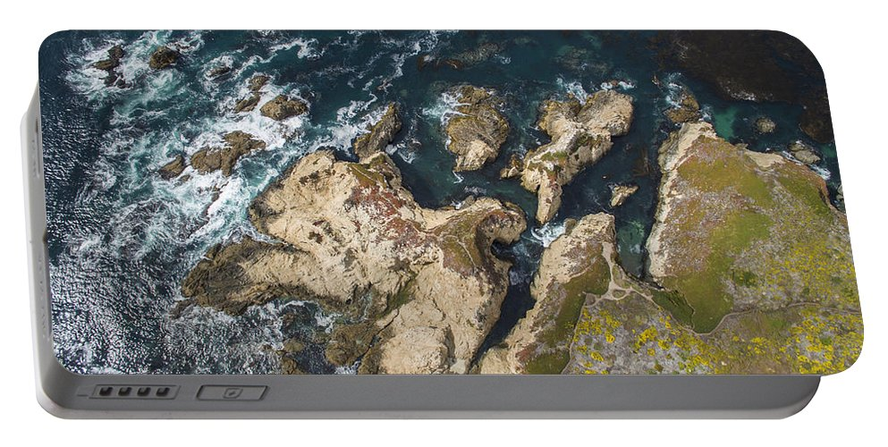 Above Portable Battery Charger featuring the photograph Coastal Crevices by David Levy
