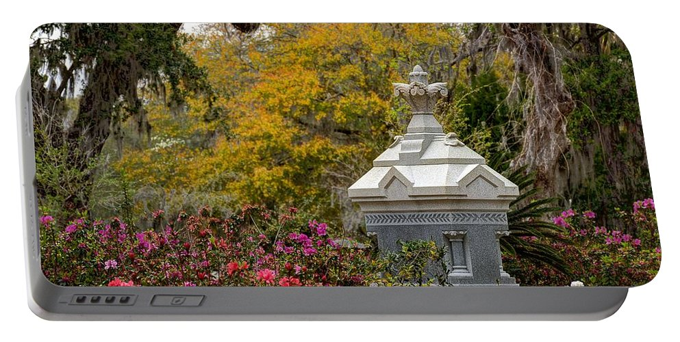 Cemetery Portable Battery Charger featuring the photograph Colorful Rest by Jeffrey Schreier