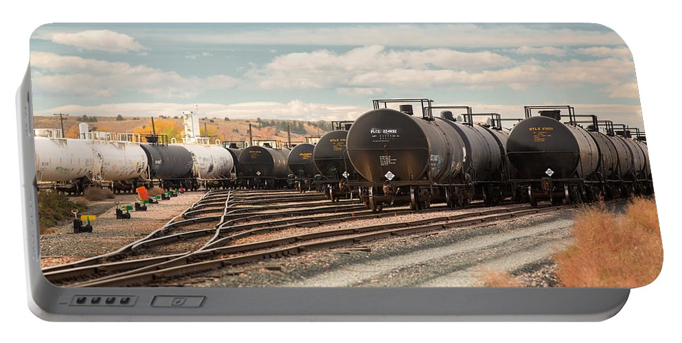 Dot-111 Portable Battery Charger featuring the photograph Congested Tracks by Todd Klassy