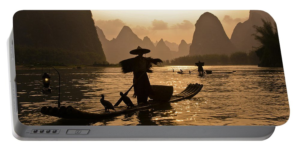 Asia Portable Battery Charger featuring the photograph Cormorant Fisherman At Sunset by Michele Burgess