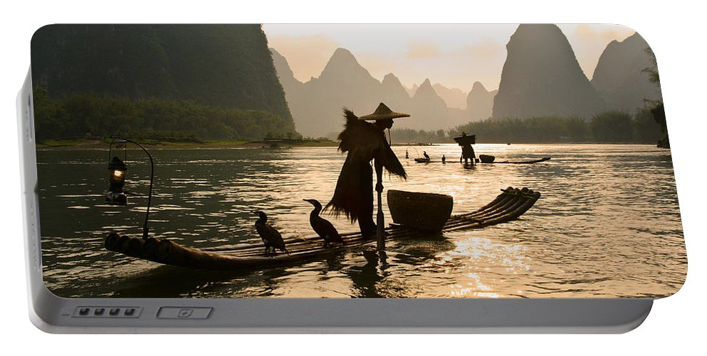 Asia Portable Battery Charger featuring the photograph Cormorant Fisherman On The Li River by Michele Burgess