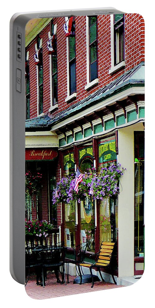 Restaurant Portable Battery Charger featuring the photograph Corner Restaurant With Hanging Plants by Susan Savad