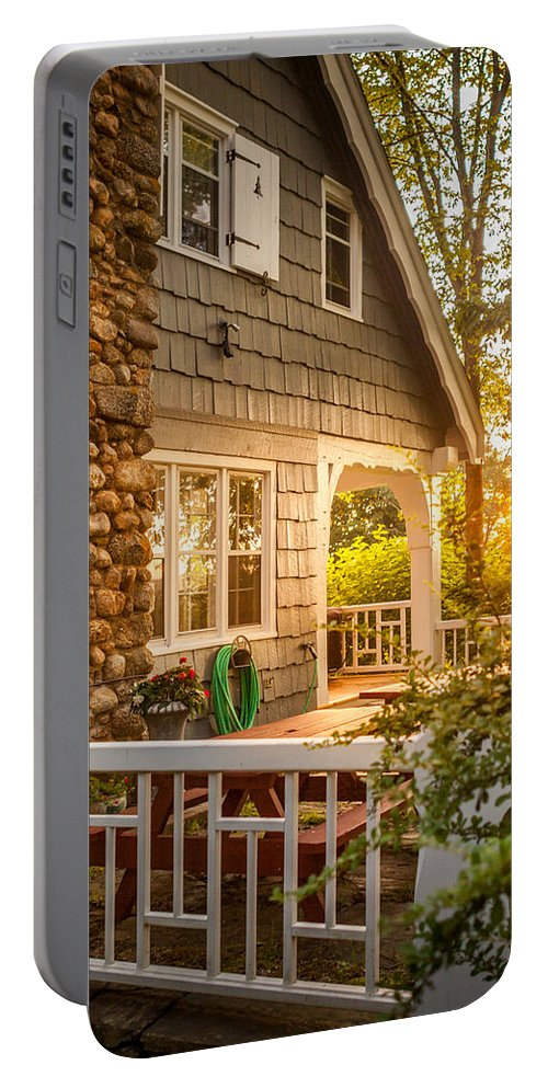 Warm Portable Battery Charger featuring the photograph Cottage Sunset In Deep Cove, Nova Scotia by Mike Organ