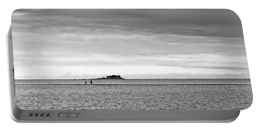 Bothian Bay Portable Battery Charger featuring the photograph Couple Walking On A Sandbank by Jukka Heinovirta