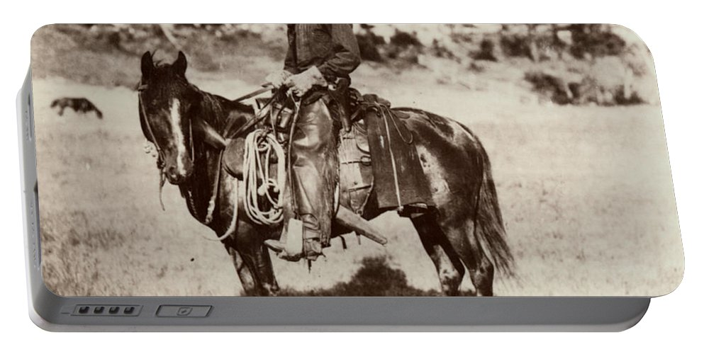 1887 Portable Battery Charger featuring the photograph Cowboy, 1887 by Granger