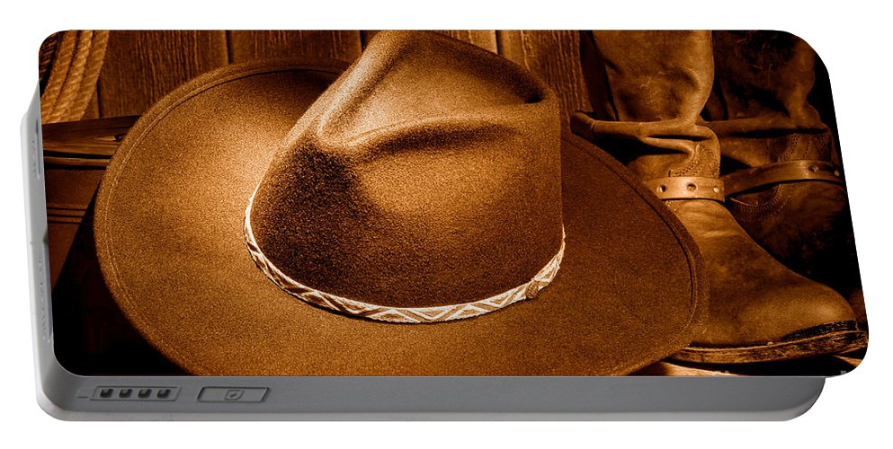Cowboy Portable Battery Charger featuring the photograph Cowboy Hat - Sepia by Olivier Le Queinec
