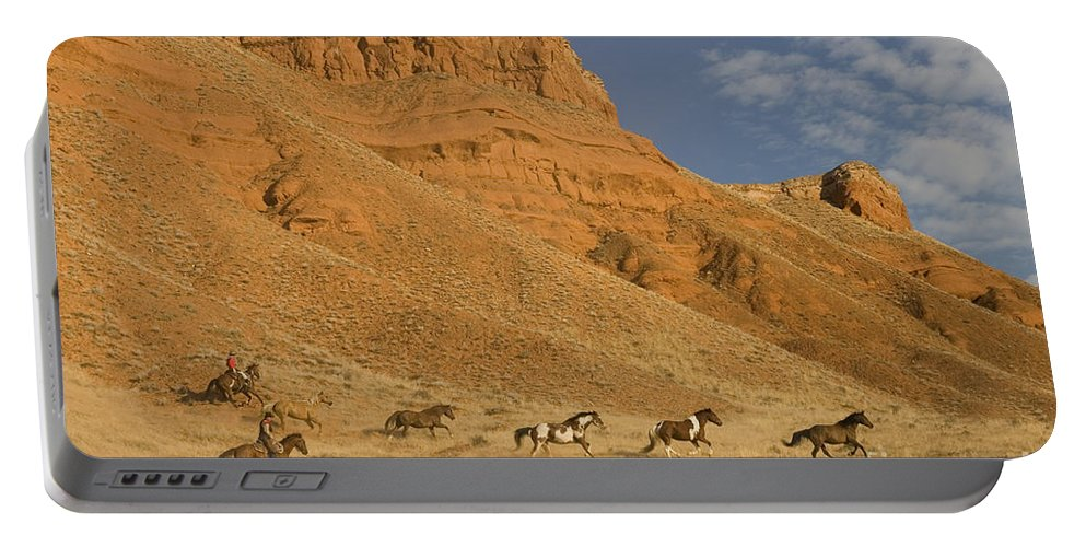 Cowboy Portable Battery Charger featuring the photograph Cowboys Chasing Horses by Jean-Louis Klein & Marie-Luce Hubert