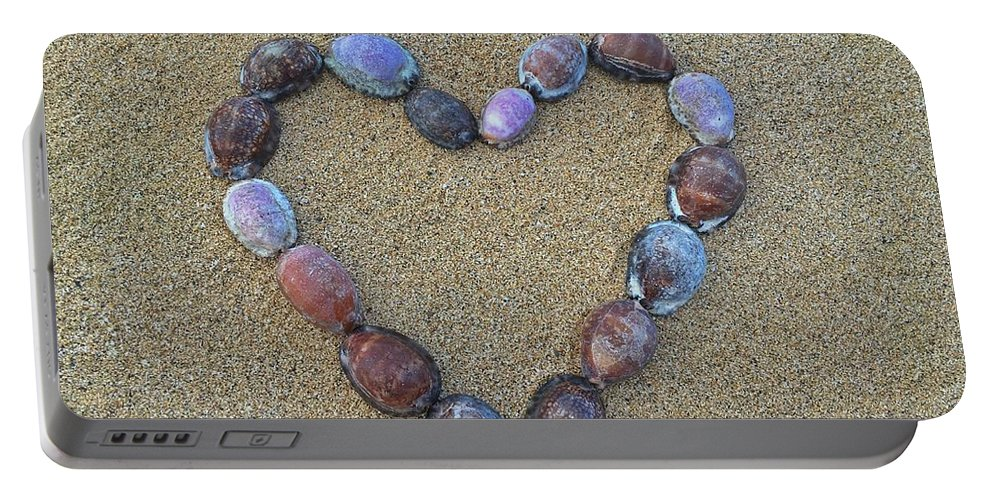 Cowrie Portable Battery Charger featuring the photograph Cowrie Love by Megan Martens