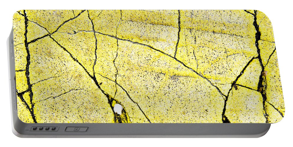 Abstract Portable Battery Charger featuring the photograph Cracked Yellow Paint by Tom Gowanlock
